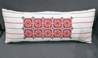 "Embroidered Lumbar Pillow. Down filled. 27.5"" w x 11""h. 125.-"