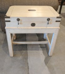 Somerset Bay 'Chesapeake' end table. Approx 5-8 years old. Distressed painted finish with metal hardware. Top lifts up for storage. Current List: $1324.80. Modele's Price: 650.-