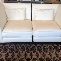 **ITEM NOW SOLD** Baker leather 2 pc. loveseat from the Jacques Garcia collection. Purchased from the Baker showroom in LA three years ago. Separate to use as two chairs. White leather. Original List. $5000-$6000.- Modele's Price: 1850.-