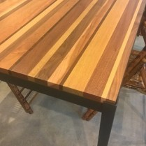 """**ITEM NOW SOLD** McKinnon 'Manhattan' dining table with solid """"medley""""top and steel frame. Wood top contains walnut, maple, cherry, oak, mahogany. Built locally, never used in home, showroom sample. 72""""l x 36""""w x 30""""h. Orig. List: $2,559. Modele's Price: 1500.-"""