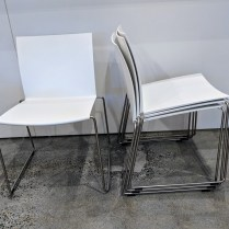 "**ITEM NOW SOLD** Set/4 MDF Italia M1 stackable dining side chairs in white. Never used. 20.5""w x 20""d x 29.5""h Current List: $1900. set/4. Modele's Price: 695. set/4"