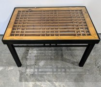 "**ITEM NOW SOLD** Custom table; Chinese wood panel inset, glass top, set in steel frame. Purchased from Del Teet approx. 15 years ago. 29.75"" x 19 1/8"" x 18""h. 450.-"