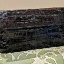 "**ITEM NOW SOLD** Nancy Gonzalez crocodile clutch, used 3-4 times. Purchased at Neiman Marcus 7 years ago. 7.5""l x 4.5""h. Current List: $1,305. Modele's Price: 595.-"