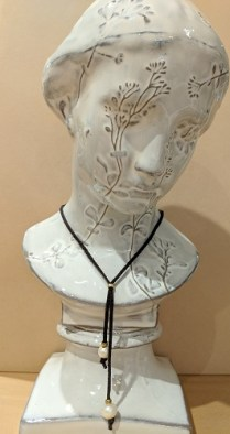 """New, Freshwater Pearl Bolo by Roost Co. Adjustable up to 34""""l. Pearls on leather cord. 50.-"""