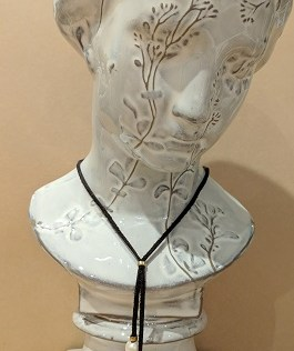 "New, Freshwater Pearl Bolo by Roost Co. Adjustable up to 34""l. Pearls on leather cord. 50.-"