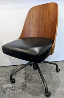 """**ITEM NOW SOLD** West Elm desk chair, approx. 4-5 years old. Leather seat, curved wood back, casters, adjustable seat height. 20""""w x 22""""d x 35.5"""" Current List: $449. Modele's Price: 225.-"""
