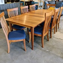 "**ITEM NOW SOLD** McKinnon solid cherry dining set with 8 side chairs. Approx. 20 yrs. old, very light use. Table includes two leaves: 72""l x 42""w x 30""h. Each leaf adds 18"" = 108"" Max. Recent List: $8000. -9000.(before store closed) Modele's Price: 3750.- set"