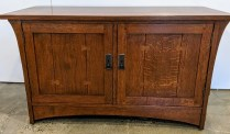 """**ITEM NOW SOLD** Stickley TV console in solid oak with dark copper hardware. 6 years old, purchased from Masins. 50""""w x 22""""d x 28""""h. Orig. List: Approx. $2000. Modele's Price: 595.-"""