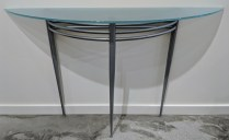 "Glass/steel demilune table. 52.5""w x 14""d x 32.75""h. Glass is frosted on bottom. 195.-"