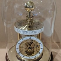 "**ITEM NOW SOLD** Hermle Astrolabium clock, made in Germany. Quartz movement, shows time/day/month/zodiac/ earth/sun/moon display. 8.25"" dia. x 11.25""h. Current List: $2,298.- Modele's Price: 695.-"