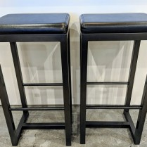 """**ITEM NOW SOLD** Pair Zeus bar-height stools. Black leather seat on steel base. 16.5"""" x 14.25"""" x 32.5""""h. Current List: $499. Each. Modele's Price: 395. Pair"""
