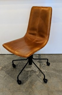 "**ITEM NOW SOLD** West Elm 'Slope' desk chair in leather. One year old. Swivel, and adjustable height. 27"" dia. x 36.25""h max. height. Current List: $449. + 44.90 freight. Modele's Price: 250.-"