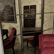 "**ITEM NOW SOLD** Grandin Road 3-panel mirrored screen, 3 years old. Each panel: 20.25""w x 72""h. Orig. List: $999. Modele's Price: 450.-"