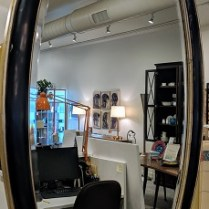 "**ITEM NOW SOLD** Harrison and Gil oval mirror, 14 yrs. old. Hardware to hang either vertically or horizontally. Black/gold finish, bevel edge in glass. 28.25"" x 49.5"". 375.-"