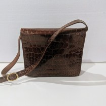 Tutti Dell'Acqua Milano crocodile handbag. Purchased from Neiman Marcus. Orig. List: $1,785. purchased on sale for $1195. (never used). Modele's Price: 595.-