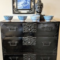 "**ITEM NOW SOLD** 2-Piece Antique Japanese tansu with black lacquer finish. Late 19th century. 33.5""w x 16.25""d x 39.5""h. Orig. List: $1,400. Modele's Price: 650.-"