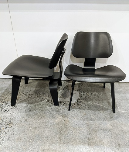 """Pair Herman Miller Eames molded plywood lounge chairs (LCW) with black stain. Made in 2004. 26.25""""w x 22""""d x 25.25""""h. Seat height: 5.5"""" Current List: $2,348. for pair, plus $235. delivery. Modele's Price: 1295. pair"""