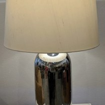 "Pair mercury glass table lamps, 5 years old. 3-way switches. 18"" dia. x 31""h. Orig. List: $1,140. pair. Modele's Price: 595. pair"
