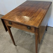 """Vintage drop-leaf side table, with metal wheels, perfectly imperfect. Lovely patina. 22"""" x 30"""" x 27.75"""" h. 250.-"""