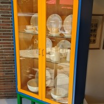 """**ITEM NOW SOLD** Karl Andersson Polychrom vitrine, purchased by special order through Egbert's 20 years ago. Lighted birch interior, adjustable glass shelves. No longer in production. 41.25""""w x 14.5""""d x 70.75""""h. Orig. list: $3,500. Modele's Price: 950.-"""