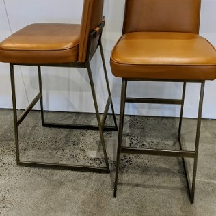 """Pair Lawson-Fenning 'Elysian' barstools. Bronze finish on steel frame, faux leather upholstery. 17.25""""w x 22""""d x 41.25""""h. Current list: $2,500. pair + fabric. Modele's Price: 1350.- pair"""