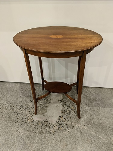 "Vintage oval side table. Mahogany with inlay. 22.5""w x 17""d x 28""h. 175.-"