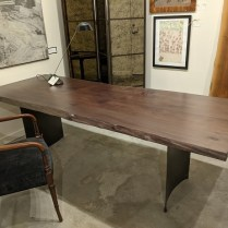 """**ITEM NOW SOLD** Meyer Wells stained maple live-edge table on steel base. Approx. 5 years old. 96""""l x 36""""w x 29.5""""h. Orig. list: $5,000. Modele's Price: 1950.-"""