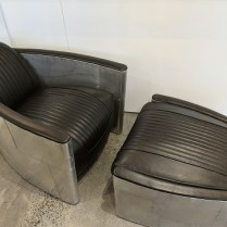 """Restoration Hardware 'Aviator' club chair with ottoman, with riveted aluminum panesl and leather. 8 years old. Chair: 29.5""""w x 37""""d x 27.25""""h. Ottoman: 26""""w x 28""""d x 15.5""""h. Current list: $3,116. Modele's Price: 1195. set"""