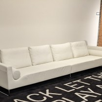 """**ITEM NOW SOLD** Bensen 'Canyon' medium sofa, designed by Niels Bendsten. Made in B.C., Canada. Purchased in 2009. Two pieces, in creamy white leather. 138""""l x 34.5""""d x 30""""h. Current list: $11,130. Modele's Price: 3500."""