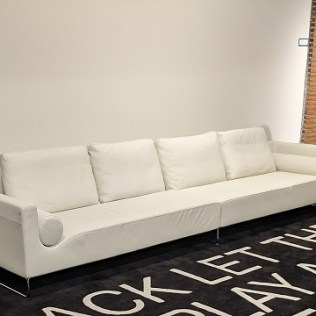 "Bensen 'Canyon' medium sofa, designed by Niels Bendsten. Made in B.C., Canada. Purchased in 2009. Two pieces, in creamy white leather. 138""l x 34.5""d x 30""h. Current list: $11,130. Modele's Price: 3950."