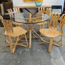 """**ITEM NOW SOLD** Knoll Frank Gehry dining set, all pieces signed and numbered. 'Face Off' table with four 'Hat Trick' side chairs, in maple. Purchased in 1997. 40"""" diameter table. Current list price: $12,922. Modele's Price: 1795. set"""