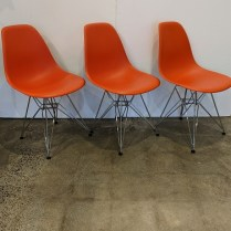 """Set/5 Vitra Eames molded plastic side dining chairs with wire bases in chrome and felt foot pads. 18""""w x 21.5""""d x 31.5""""h. Current list: $2,125. set Modele's price: 1100. set"""