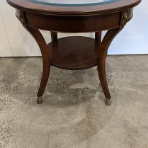 """Neoclassic style table with inset glass top. Brass feet and rings, approx. 20 years old. 29"""" dia, x 26.25""""h. Orig. list: $1,500. Modele's price: 595."""