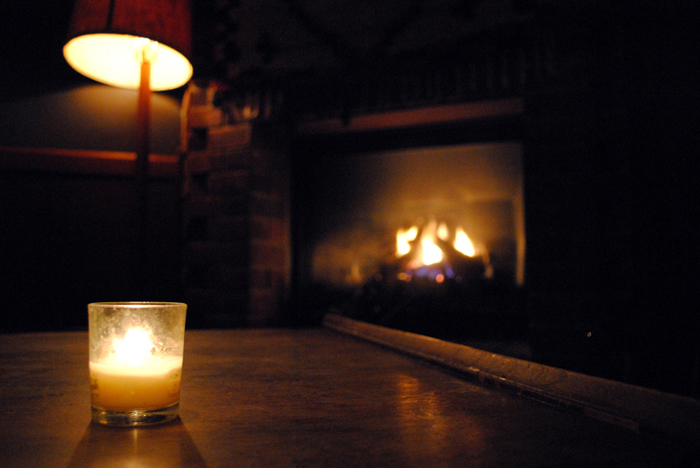 Mood lighting near the cozy fireplace at Broken Shaker Chicago