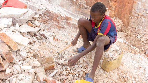 A child works in a mine.