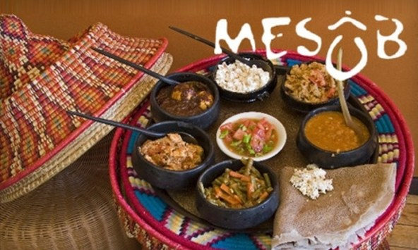 Picture of Ethiopian Food on a tray with the words Mesob written over the picture