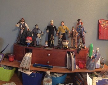 Action figures on office desk