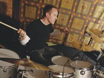 Drummer Josh Freese playing at his drumkit