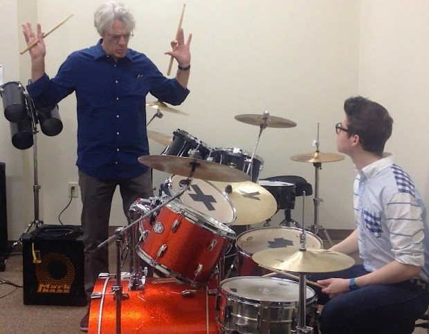 Photo by Tim Kane World-renowned drummer and composer Stewart Copeland expresses the importance of mastering the paradiddle rudiment to his student Chris Barry at Eagle Hill School in Hardwick last Thursday.