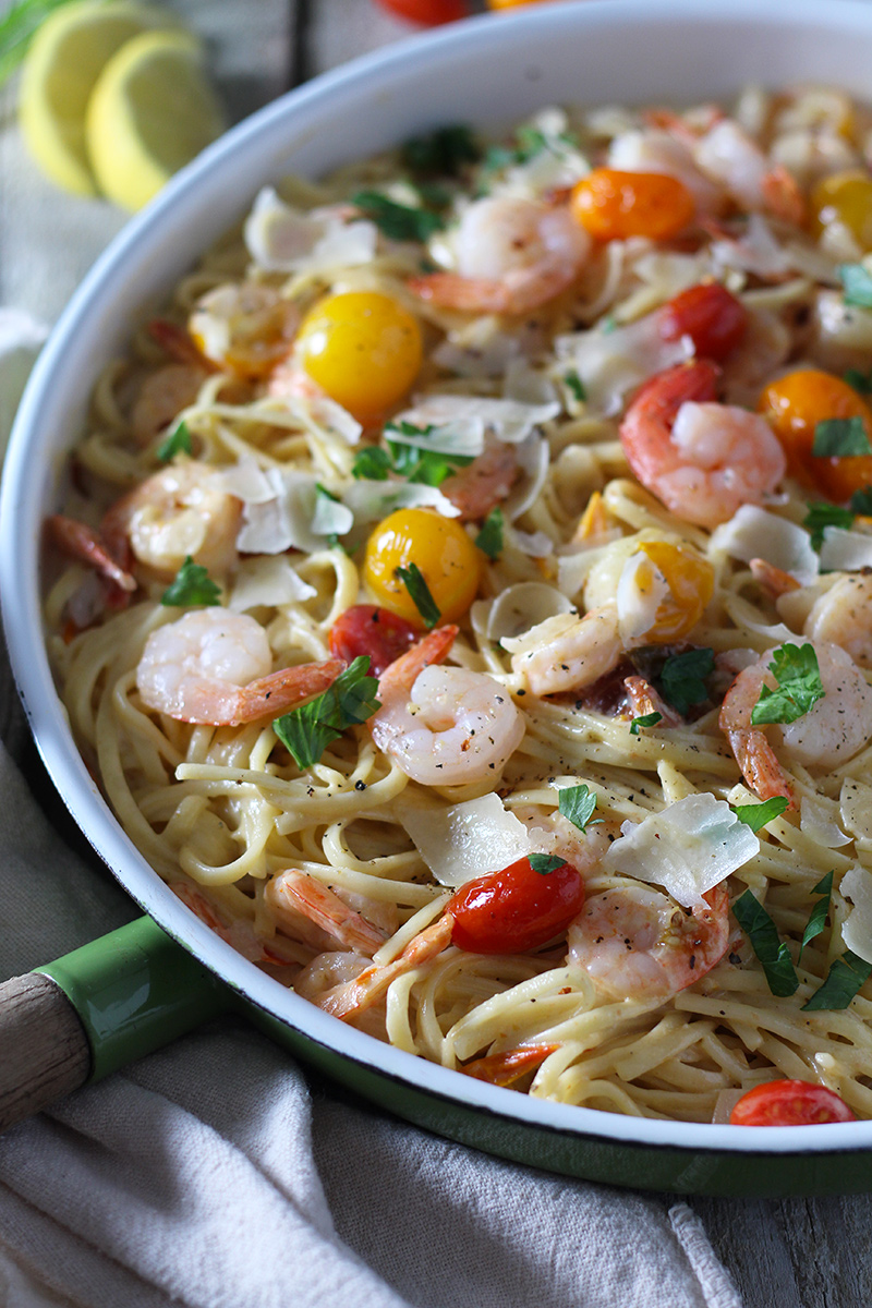 Shrimp Scampi meets alfredo! This delicious pasta is ready in 30 minutes and is packed with flavor from burst tomatoes, garlic, fresh squeezed lemon and parmesan.