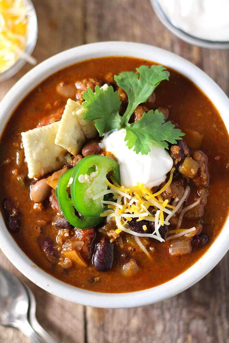 Hearty, easy-to-make chili with a kick! Loaded with five kinds of peppers from sweet to spicy, made with a full can of beer and homemade chili seasoning, and packed with beef and 4 kinds of beans.