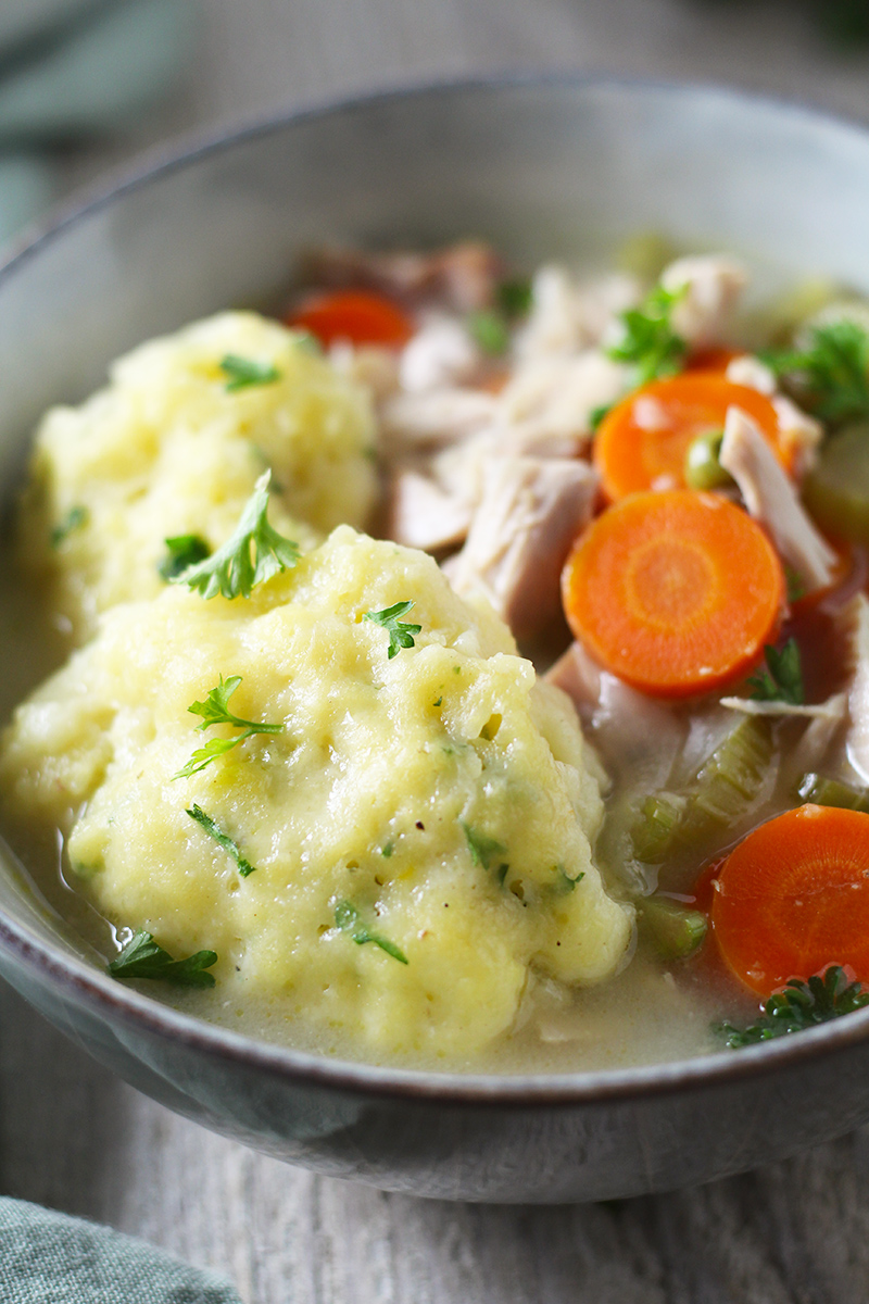 A classic and hearty Chicken and Dumplings Soup From Scratch! This easy recipe is made using a whole chicken, loaded with vegetables, and topped with fluffy homemade dumplings.