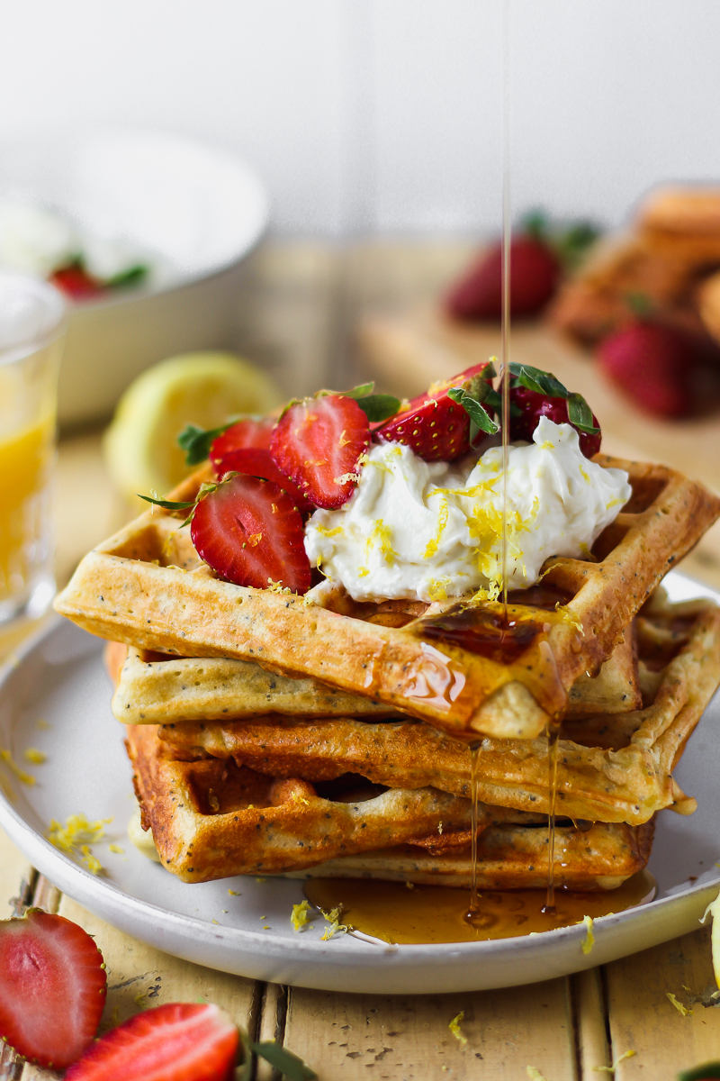 Fluffy on the inside and crisp on the outside, these lemon poppy seed waffles are a definite crowd pleaser! Topped with whipped honey lemon cream that's bursting with fresh lemon flavor and just the right touch of sweetness. These waffles are like summer in your mouth.