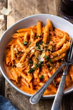 penne alla vodka with a glass of red wine