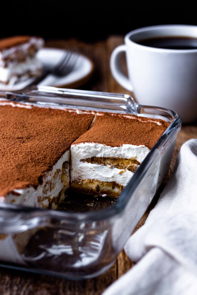 Espresso and coffee liqueur dipped ladyfingers get layered with creamy, fluffy, lightly sweetened mascarpone whipped cream and dusted with rich cocoa powder. This easy, fresh, super delicious no-bake Italian dessert has all the best Tiramisu flavors but without raw eggs.