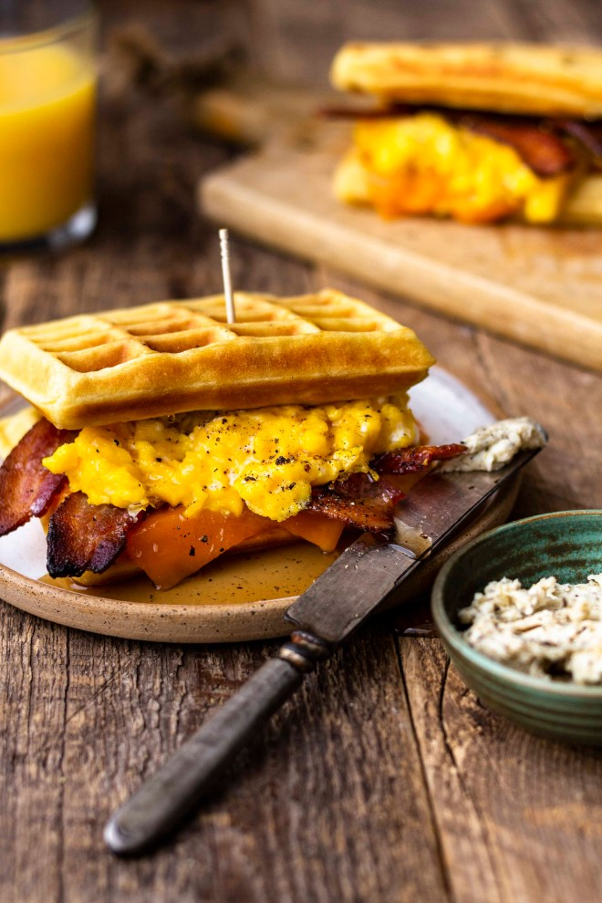 waffle breakfast sandwich with peppered maple bacon