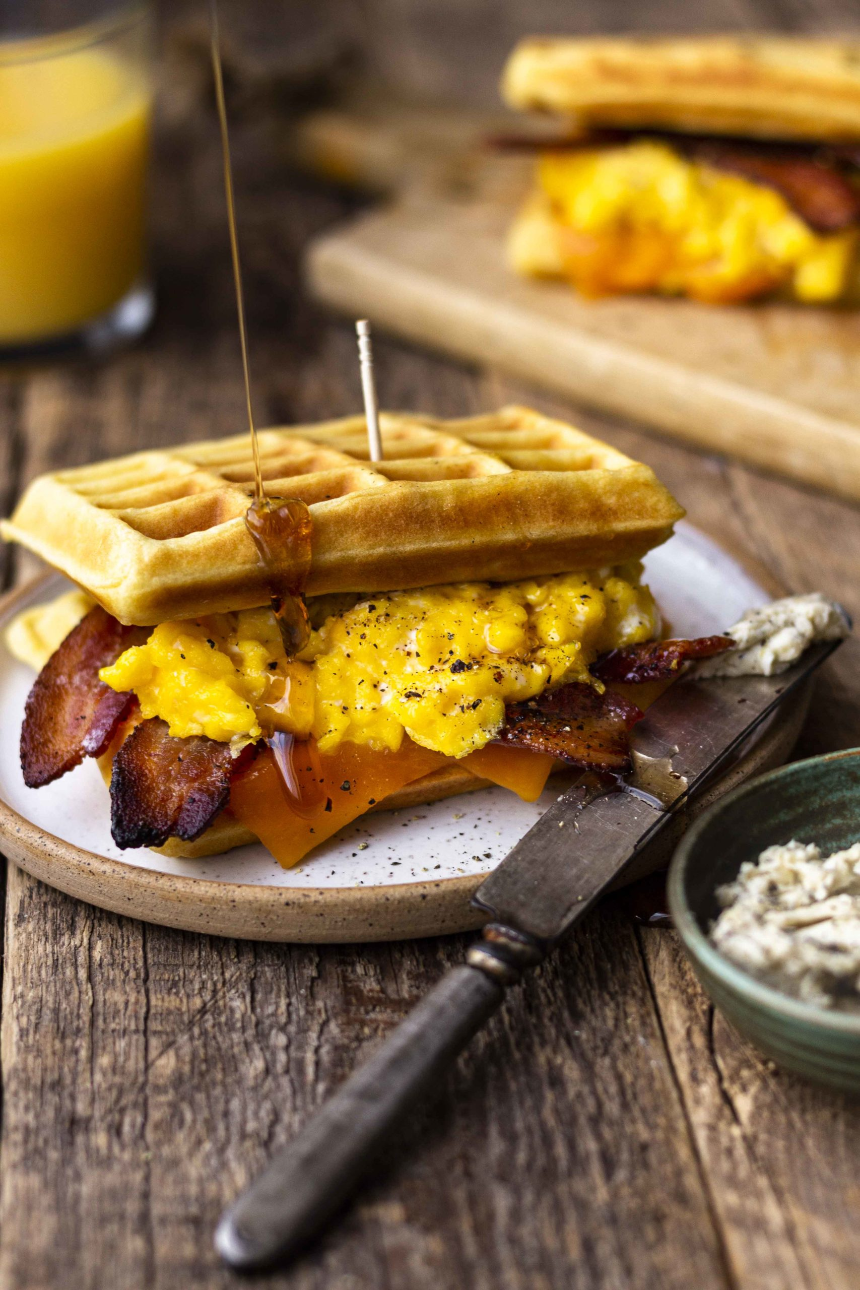 waffle breakfast sandwich with maple syrup drizzle