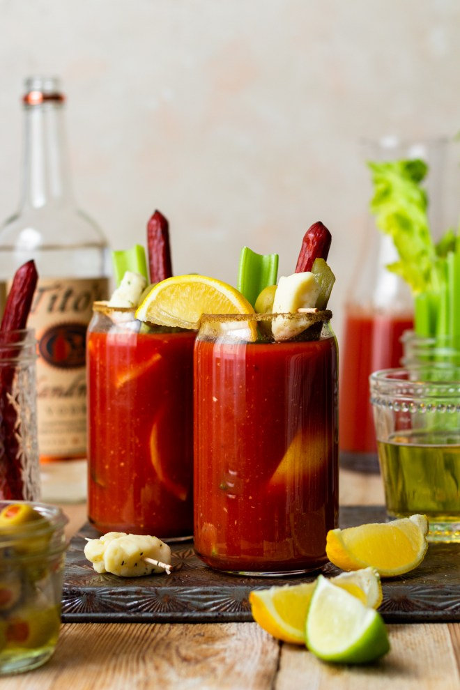 Homemade Bloody Mary mix that is so simple to mix up and is so much better than premix! It'll be your new favorite cocktail to kick off weekend brunch! The best Bloody Mary mix starts with tomato juice and Clamato, then is infused with tons of flavor from fresh lemon and lime juice, pickle juice, Worcestershire, and a touch of heat from hot sauce and horseradish! You'll be coming back to this recipe over and over! Say goodbye to premix!
