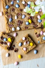 Crispy around the edges and chewy, gooey and buttery on the inside! Chocolate Easter Egg Cookie Bars are an easy to make, fun Easter treat that are studded with Cadbury Milk Chocolate Mini Eggs! These cookie bars are also a good way to use up any leftover chocolate Easter candy! Just add some of your favorite candy to the dough, such as M&M's or chocolate caramels! So so good!