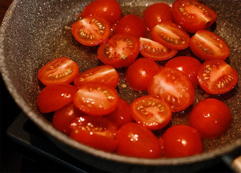 tomatoes on cooktop in grill pan